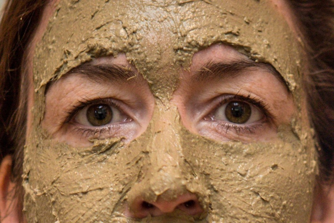 Woman wearing a deep cleansing mud mask